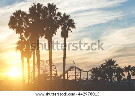 Santa monica pier with palms silhouettes Royalty-Free Stock Photo #442978015
