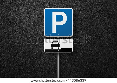 Road signs on a background of asphalt. Parking. The texture of the tarmac, top view.