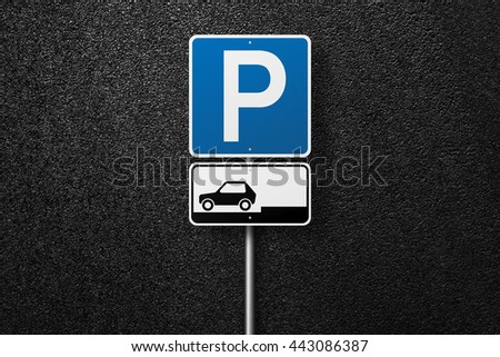 Road sign on a background of asphalt. Parking. The texture of the tarmac, top view.