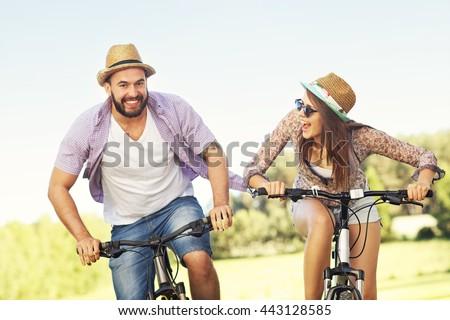 Picture of romantic couple riding bikes