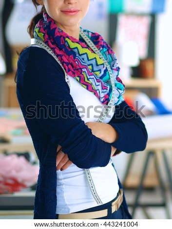 Beautiful fashion designer standing in studio #443241004