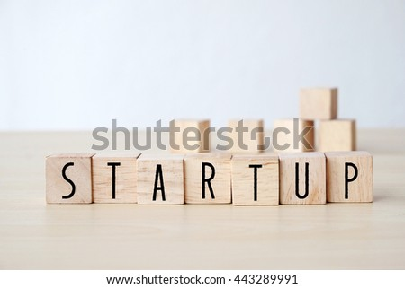 Start up word on wooden cubes background, business concept #443289991