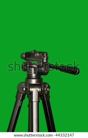 A carbon fiber tripod isolated on green background