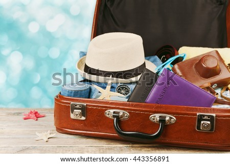 Packed vintage suitcase for summer holidays, vacation, travel and trip. Retro toning. Royalty-Free Stock Photo #443356891