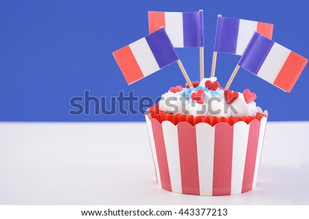 Happy Bastille Day cupcake with red, white and blue french flags.