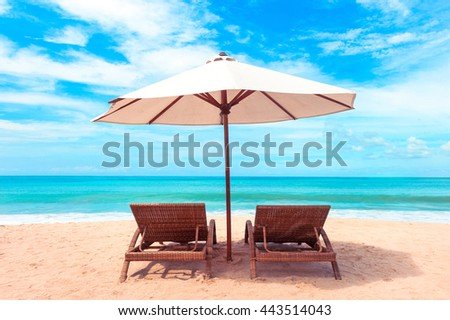 Beautiful beach. Chairs on the  sandy beach near the sea. Summer holiday and vacation concept. #443514043