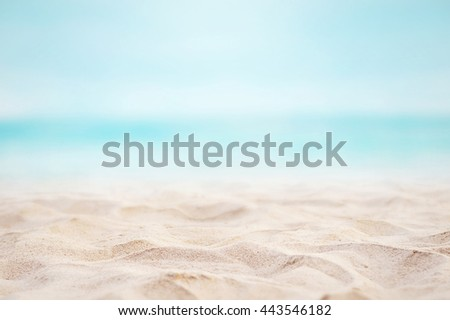 Close up sand with blurred sea sky background, summer day, copy space or for product. Summer background concept. #443546182