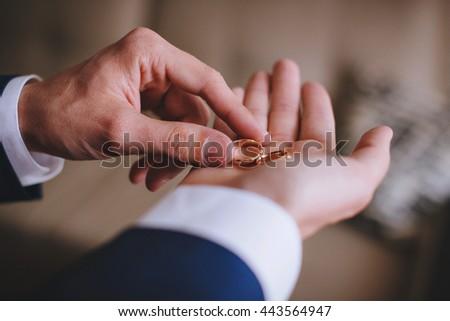 Wedding ring on the hand of man groom #443564947
