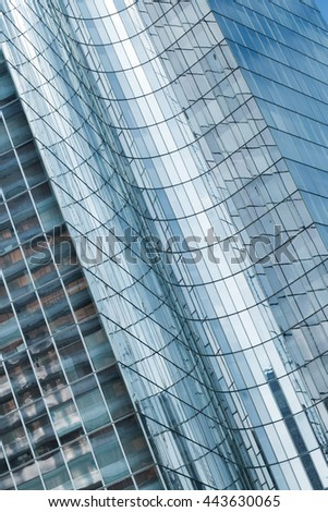 Skyscrapers with glass facade. Modern buildings in Paris business district. Concepts of economics, financial, future.  Copy space for text. Dynamic composition #443630065
