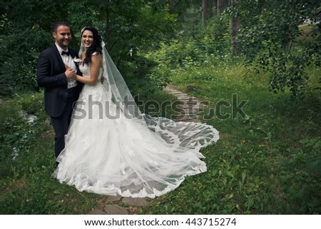 The happiest couple in love embracing in the park #443715274