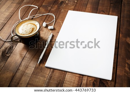Blank branding template on vintage wooden table background. Blank letterhead, coffee cup, headphones and pen. Photo of blank stationery. Mock-up for your design. Responsive design template. Royalty-Free Stock Photo #443769733