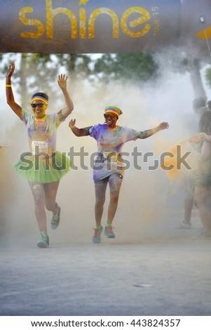 MAMAIA, CONSTANTA, ROMANIA - AUGUST 1: Mamaia color run 2015, in Mamaia, Constanta, on August 1, 2015. People from all walks of life participating in the fun  #443824357