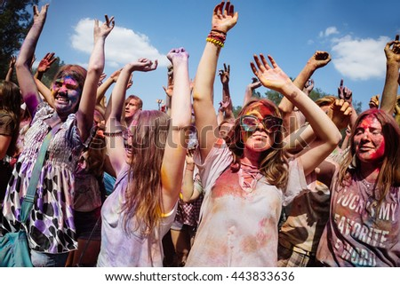 KIEV, UKRAINE - Jun 25, 2016: Crowd of happy young people have fun in colors during festival of colors ColorFest #443833636