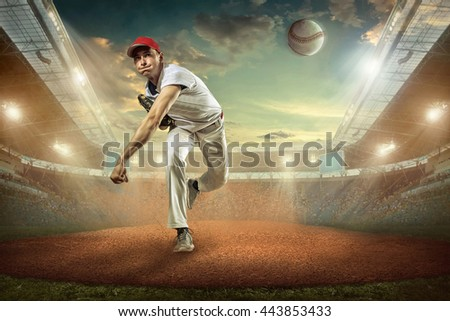 Baseball players in action on the stadium. #443853433