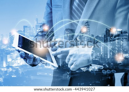 double exposure of businessmen using tablet with blur city night and network connection concept  #443941027