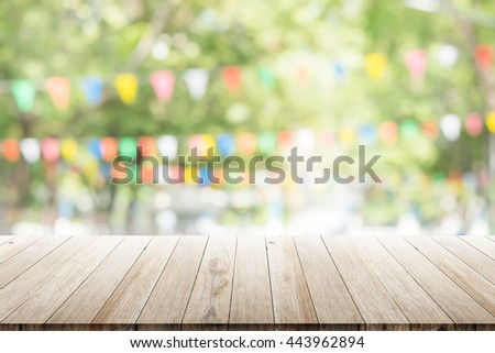 Empty wooden table with blurred party on background. fun / spring concept #443962894