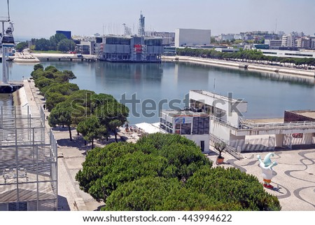 LISBON, PORTUGAL - JUNE 16, 2015: Cityscape view from the cable car funicular railway over the coastline of the Lisbon Oceanarium in the Parque das Nacoes (Park of Nations), Portugal.  #443994622