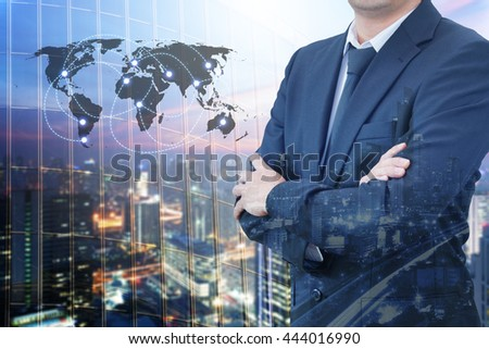 Double exposure of professional businessman standing crossed arms and cityscape with modern office building background, Business & Real estate agency concept ,element of this image furnished by NASA #444016990