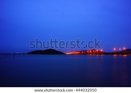 Abstract background blurry image of lake view on night time at southern Thailand:Unfocus image:ideal use for background. #444032050