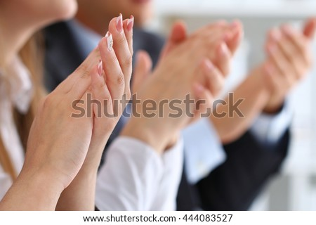 Close up view of business seminar listeners clapping hands. Professional education, business meeting, presentation or coaching concept #444083527
