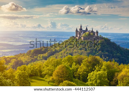 Aerial view of famous Hohenzollern Castle, ancestral seat of the imperial House of Hohenzollern and one of Europe's most visited castles, in beautiful golden evening light, Baden-Wurttemberg, Germany Royalty-Free Stock Photo #444112507