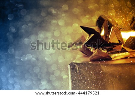 close up of gift box bow on shiny background