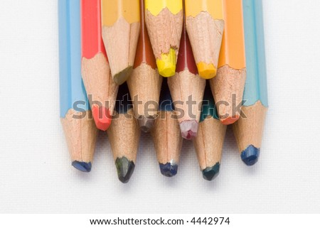 close-up of colored pencils stacked #4442974