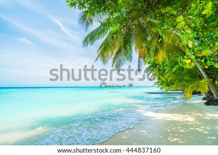 Beautiful tropical Maldives resort hotel and island with beach and sea on sky for holiday vacation background concept - Boost up color Processing #444837160