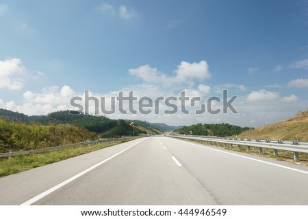 Highway pavement asphalt road in mountain hill at East Coast Expressway Malaysia #444946549