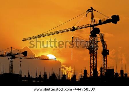 silhouette of construction site crane #444968509