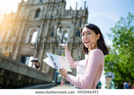 Woman holding city guide in Macao city #445046491