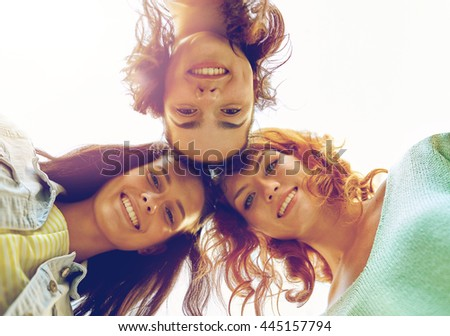 vacation, weekend, leisure and friendship concept - smiling happy young women or teenage girls in circle
