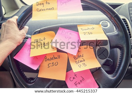 Steering wheel covered in notes as a reminder of errands to do Royalty-Free Stock Photo #445215337