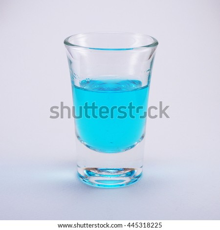 alcohol in measuring cup on white background. #445318225