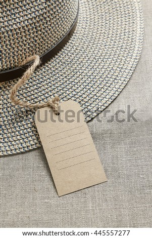 Fedora hat with paper price label on jute background. Copy space. #445557277