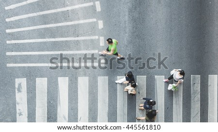 Busy city people are walking to pedestrian crossing on traffic road (Aerial photo, top view) #445561810