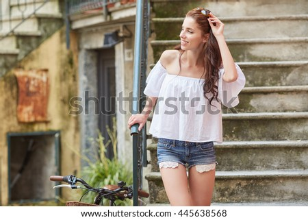 Close-up Fashion woman portrait of young pretty trendy girl posing at the city in Europe #445638568