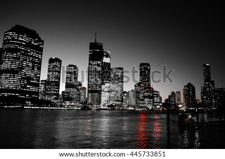 Night skyline in black and white with single red color
