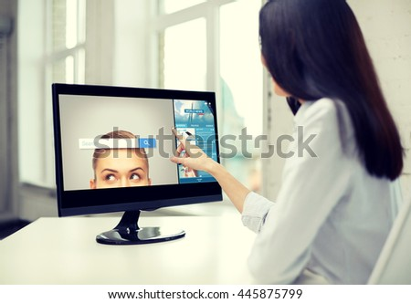 business, people, technology and internet concept - close up of woman pointing finger to web browser search bar on computer monitor in office #445875799