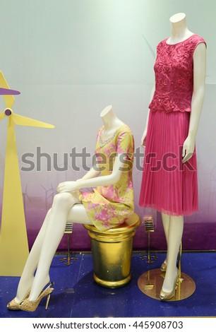 showcase model in store window #445908703