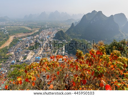 Beautiful karst mountains and autumn bush on foreground. View from the hill above town of the Hingping - China #445950103