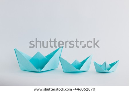 three blue paper boats on white  background  #446062870