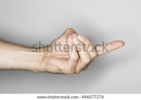 Yoga gesture. Hand in vajra mudra by Caucasian man isolated in the studio. Gesture of the fiery thunderbolt #446077276