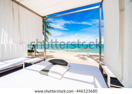 Outdoor deck with pillow neary beach and sea with coconut palm tree on blue sky background #446123680