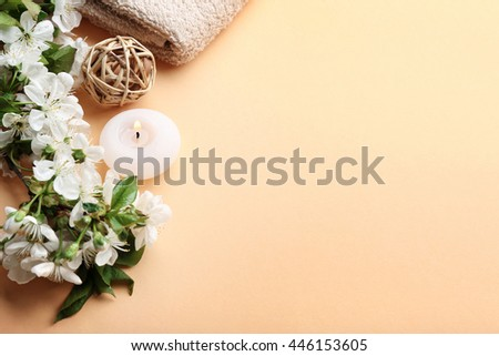 Spa treatment with blooming branch on beige background #446153605