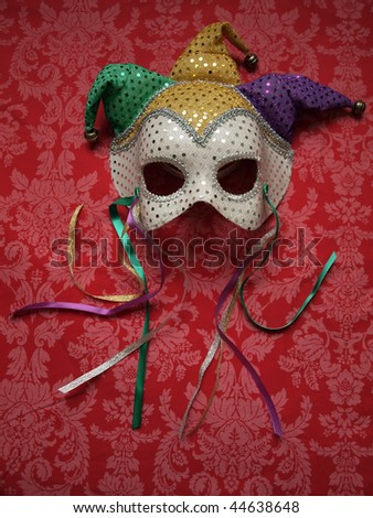photo of a carnival mask on decorative fabric. Copy and cropping space included!