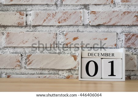 December 1st. Image of december 1 wooden color calendar on white brick wall background. empty space for text.  Royalty-Free Stock Photo #446406064