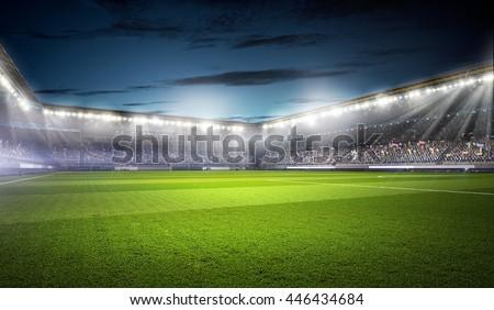 Football stadium in lights . mixed media Royalty-Free Stock Photo #446434684