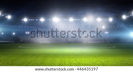 Football stadium in lights . mixed media Royalty-Free Stock Photo #446435197