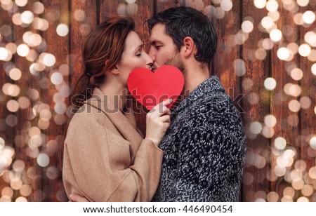 boyfriend and girlfriend kisisng behind #446490454